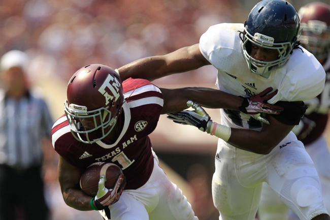 Aug 31, 2013; College Station, TX, USA; Texas A&M Aggies running back Ben Malena (1) stiff arms Rice Owls defensive end Brian Nordstrom (47) during the second half at Kyle Field. Texas A&M won 52-31. Mandatory Credit: Thomas Campbell-USA TODAY Sports