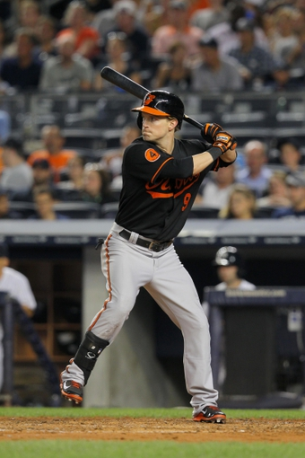 Aug 30, 2013; Bronx, NY, USA; Baltimore Orioles left fielder Nate McLouth (9) bats against the New York Yankees during a game at Yankee Stadium. Mandatory Credit: Brad Penner-USA TODAY Sports