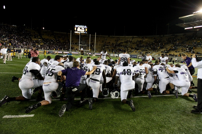Aug 31, 2013; Berkeley, CA, USA; Northwestern Wildcats gather in a circle after the win against the California Golden Bears at Memorial Stadium. Northwestern won 44-30. Mandatory Credit: Kelley L Cox-USA TODAY Sports