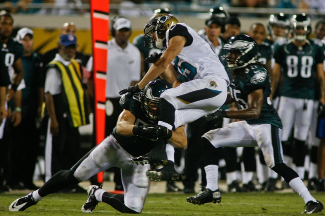 Aug 24, 2013; Jacksonville, FL, USA; Philadelphia Eagles linebacker Casey Matthews (50) hits Jacksonville Jaguars wide receiver Jordan Shipley (15) in the fourth quarter of their game at EverBank Field. The Philadelphia Eagles beat the Jacksonville Jaguars 31-24. Mandatory Credit: Phil Sears-USA TODAY Sports