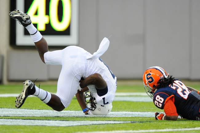 Aug 31, 2013; East Rutherford, NJ, USA; Penn State Nittany Lions wide receiver Geno Lewis (7) rolls in to the end zone for a touchdown in front of Syracuse Orange safety Jeremi Wilkes (28) during the third quarter at MetLife Stadium.  Penn State defeated Syracuse 23-17.  Mandatory Credit: Rich Barnes-USA TODAY Sports