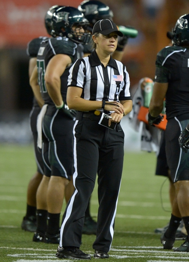Aug 29, 2013; Honolulu, HI, USA; Line judge referee Catherine Conti during the NCAA football game between the Southern California Trojans and the Hawaii Rainbow Warriors at Aloha Stadium.  Mandatory Credit: Kirby Lee-USA TODAY Sports