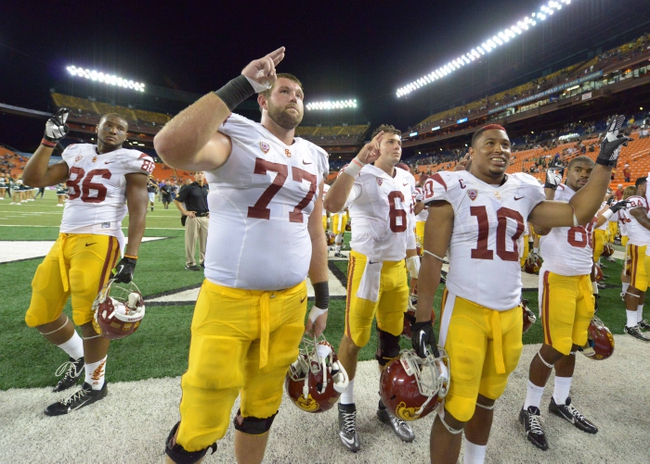 Aug 29, 2013; Honolulu, HI, USA; Southern California Trojans players Xavier Grimble (86), Kevin Graf (77), Cody Kessler (6) and Hayes Pullard (10) react at the end of the game against the Hawaii Rainbow Warriors at Aloha Stadium. USC defeated Hawaii 30-13. Mandatory Credit: Kirby Lee-USA TODAY Sports