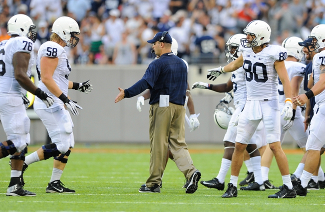 Aug 31, 2013; East Rutherford, NJ, USA; Penn State Nittany Lions head coach Bill O'Brien greets players on the sidelines during the third quarter against the Syracuse Orange at MetLife Stadium.  Penn State defeated Syracuse 23-17.  Mandatory Credit: Rich Barnes-USA TODAY Sports