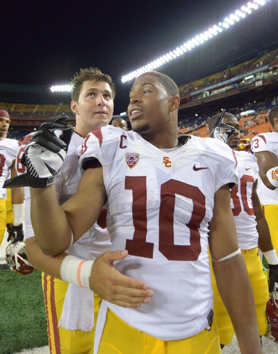 Aug 29, 2013; Honolulu, HI, USA; Southern California Trojans players Hayes Pullard (10) and Cody Kessler (6) celebrate after the game against the Hawaii Rainbow Warriors at Aloha Stadium. USC defeated Hawaii 30-13. Mandatory Credit: Kirby Lee-USA TODAY Sports