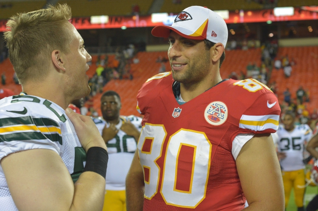 Aug 29, 2013; Kansas City, MO, USA; Green Bay Packers inside linebacker A.J. Hawk (50) talks with Kansas City Chiefs tight end Anthony Fasano (80) after the game at Arrowhead Stadium. The Chiefs won 30-8. Mandatory Credit: Denny Medley-USA TODAY Sportsds