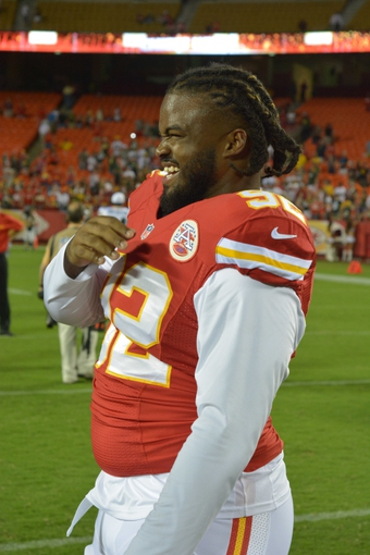 Aug 29, 2013; Kansas City, MO, USA; Kansas City Chiefs defensive end Dontari Poe (92) jokes with teammates  after the game against the Green Bay Packers at Arrowhead Stadium. The Chiefs won 30-8. Mandatory Credit: Denny Medley-USA TODAY Sportsds