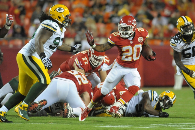 Aug 29, 2013; Kansas City, MO, USA; Kansas City Chiefs running back Shaun Draughn (20) runs the ball as Green Bay Packers defensive end Josh Boyd (93) attempts the tackle during the second half of the game at Arrowhead Stadium. The Chiefs won 30-8. Mandatory Credit: Denny Medley-USA TODAY Sports