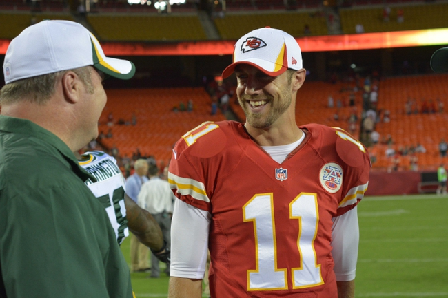 Aug 29, 2013; Kansas City, MO, USA; Green Bay Packers head coach Mike McCarthy talks with Kansas City Chiefs quarterback Alex Smith (11) after the game at Arrowhead Stadium. The Chiefs won 30-8. Mandatory Credit: Denny Medley-USA TODAY Sports