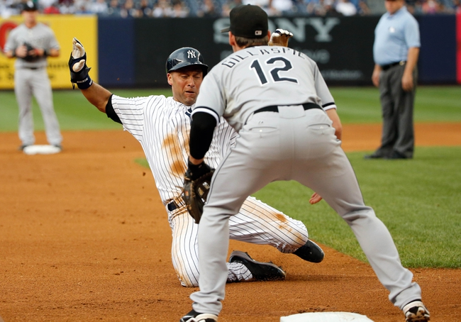 Sep 2, 2013; Bronx, NY, USA;  New York Yankees shortstop Derek Jeter (2) advances to third as Chicago White Sox third baseman Conor Gillaspie (12) waits for the ball during the first inning at Yankee Stadium. Mandatory Credit: Anthony Gruppuso-USA TODAY Sports
