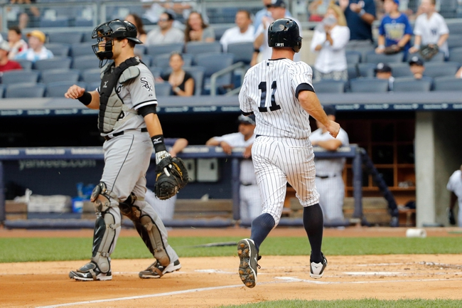 Sep 2, 2013; Bronx, NY, USA;  New York Yankees center fielder Brett Gardner (11) crosses the plate to score during the first inning against the Chicago White Sox at Yankee Stadium. Mandatory Credit: Anthony Gruppuso-USA TODAY Sports