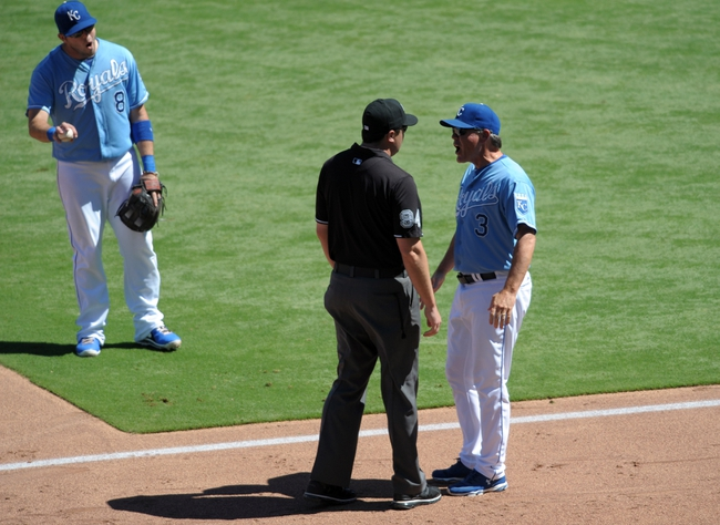 Sep 2, 2013; Kansas City, MO, USA; Kansas City Royals manager Ned Yost (3) speaks to second base umpire Lance Barrett (94) in the third inning of the game against the Seattle Mariners at Kauffman Stadium. Mandatory Credit: Denny Medley-USA TODAY Sports