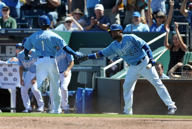 Sep 2, 2013; Kansas City, MO, USA; Kansas City Royals center fielder Jarrod Dyson (1) is congratulated by second baseman Emilio Bonifacio (64) after scoring on a wild pitch in the fifth inning of the game against the Seattle Mariners at Kauffman Stadium. Mandatory Credit: Denny Medley-USA TODAY Sports