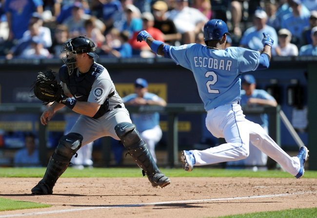 Sep 2, 2013; Kansas City, MO, USA; Kansas City Royals shortstop Alcides Escobar (2) scores past Seattle Mariners catcher Mike Zunino (3) in the fifth inning at Kauffman Stadium. Mandatory Credit: Denny Medley-USA TODAY Sports