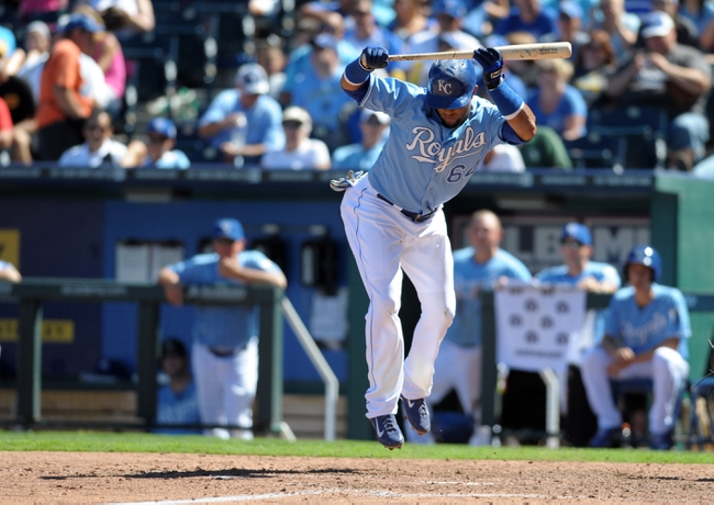 Sep 2, 2013; Kansas City, MO, USA; Kansas City Royals second baseman Emilio Bonifacio (64) reacts to an inside pitch in the fifth inning of the game against the Seattle Mariners at Kauffman Stadium. Mandatory Credit: Denny Medley-USA TODAY Sports
