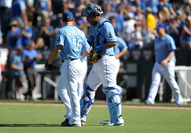 Sep 2, 2013; Kansas City, MO, USA; Kansas City Royals relief pitcher Greg Holland (56) is congratulated by catcher Salvador Perez (13) at the end of the game against the Seattle Mariners at Kauffman Stadium. The Royals won 3-1. Mandatory Credit: Denny Medley-USA TODAY Sports