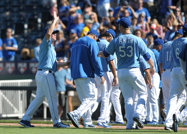 Sep 2, 2013; Kansas City, MO, USA; Kansas City Royals manager Ned Yost (3) congratulates relief pitcher Will Smith (53) at the end of the game against the Seattle Mariners at Kauffman Stadium. The Royals won 3-1. Mandatory Credit: Denny Medley-USA TODAY Sports