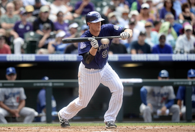 Sept 2, 2013; Denver, CO, USA; Colorado Rockies second baseman DJ LeMahieu (9) attempts a bunt in the first inning against the Los Angeles Dodgers at Coors Field. Mandatory Credit: Ron Chenoy-USA TODAY Sports