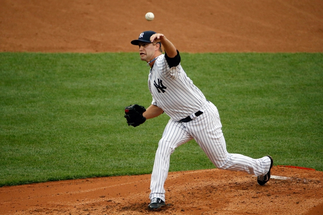 Sep 2, 2013; Bronx, NY, USA; New York Yankees relief pitcher David Huff (60) delivers a pitch during the third inning against the Chicago White Sox at Yankee Stadium. Mandatory Credit: Anthony Gruppuso-USA TODAY Sports