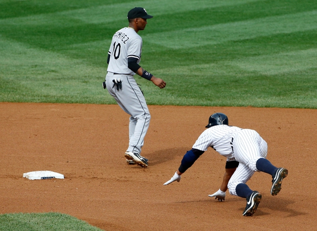 Sep 2, 2013; Bronx, NY, USA; New York Yankees third baseman Alex Rodriguez (13) slides to second as Chicago White Sox shortstop Alexei Ramirez (10) waits for the ball during the fourth inning at Yankee Stadium. Mandatory Credit: Anthony Gruppuso-USA TODAY Sports