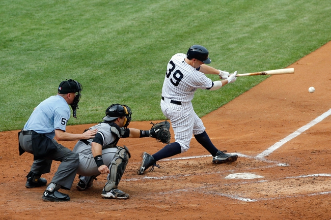 Sep 2, 2013; Bronx, NY, USA;  New York Yankees first baseman Mark Reynolds (39) reaches on infield single to third allowing a runner to score and two men to advance during the fourth inning against the Chicago White Sox at Yankee Stadium. Mandatory Credit: Anthony Gruppuso-USA TODAY Sports