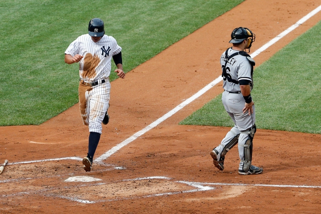 Sep 2, 2013; Bronx, NY, USA;  New York Yankees third baseman Alex Rodriguez (13) crosses the plate to score during the fourth inning against the Chicago White Sox at Yankee Stadium. Mandatory Credit: Anthony Gruppuso-USA TODAY Sports