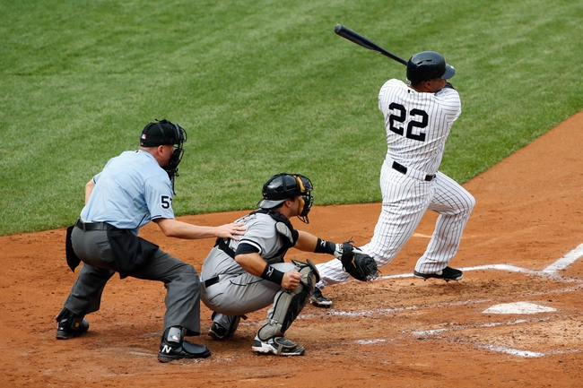 Sep 2, 2013; Bronx, NY, USA;  New York Yankees left fielder Vernon Wells (22) reaches on infield single to the shortstop during the fourth inning against the Chicago White Sox at Yankee Stadium. Mandatory Credit: Anthony Gruppuso-USA TODAY Sports