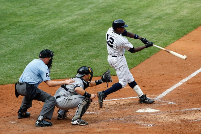 Sep 2, 2013; Bronx, NY, USA;  New York Yankees left fielder Alfonso Soriano (12) doubles to left allowing a runner to score during the fourth inning against the Chicago White Sox at Yankee Stadium. Mandatory Credit: Anthony Gruppuso-USA TODAY Sports