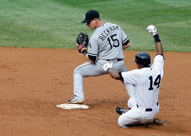 Sep 2, 2013; Bronx, NY, USA;  Chicago White Sox second baseman Gordon Beckham (15) has New York Yankees right fielder Curtis Granderson (14) out during the fourth inning at Yankee Stadium. Mandatory Credit: Anthony Gruppuso-USA TODAY Sports