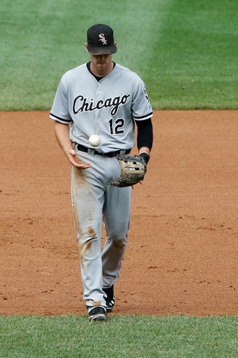 Sep 2, 2013; Bronx, NY, USA;  Chicago White Sox third baseman Conor Gillaspie (12) fails to throw during the fourth inning against the New York Yankees at Yankee Stadium. Mandatory Credit: Anthony Gruppuso-USA TODAY Sports