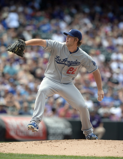 Sept 2, 2013; Denver, CO, USA; Los Angeles Dodgers starting pitcher Clayton Kershaw (22) delivers a pitch in the first inning against the Colorado Rockies at Coors Field. Mandatory Credit: Ron Chenoy-USA TODAY Sports