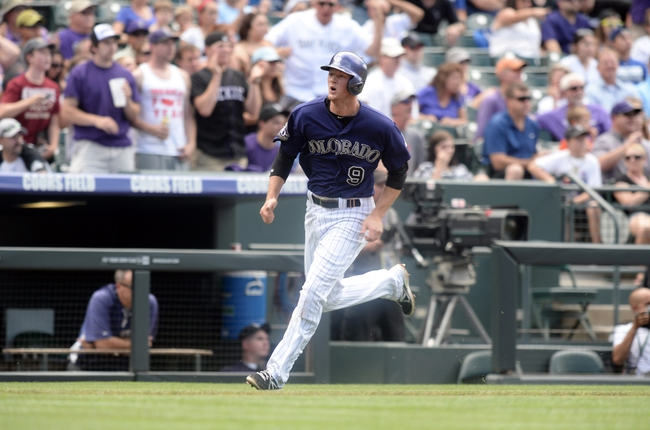 Sept 2, 2013; Denver, CO, USA; Colorado Rockies second baseman DJ LeMahieu (9) comes home to score in the first inning against the Los Angeles Dodgers at Coors Field. Mandatory Credit: Ron Chenoy-USA TODAY Sports