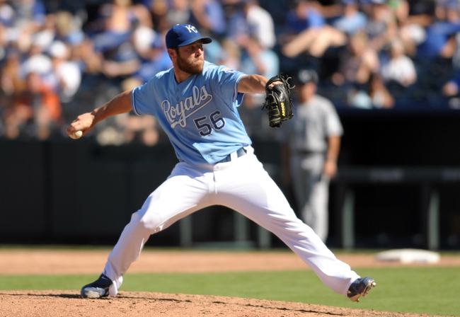 Sep 2, 2013; Kansas City, MO, USA; Kansas City Royals relief pitcher Greg Holland (56) delivers a pitch in the ninth inning of the game against the Seattle Mariners at Kauffman Stadium. The Royals won 3-1. Mandatory Credit: Denny Medley-USA TODAY Sports