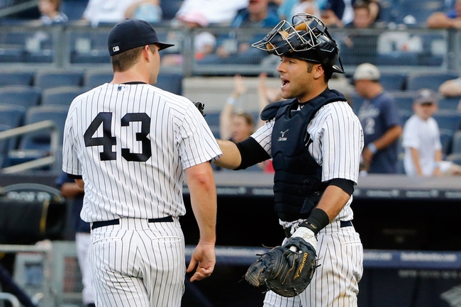 Sep 2, 2013; Bronx, NY, USA;  New York Yankees relief pitcher Adam Warren (43) and catcher Austin Romine (53) celebrate the win against the Chicago White Sox at Yankee Stadium. Yankees won 9-1.  Mandatory Credit: Anthony Gruppuso-USA TODAY Sports
