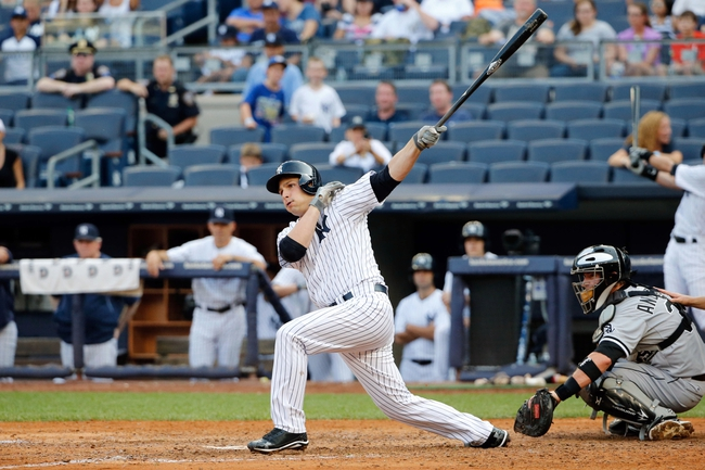 Sep 2, 2013; Bronx, NY, USA;  New York Yankees catcher J.R. Murphy (66) hitting for second baseman Robinson Cano (24) (not pictured) reaches on an infield single to third during the eighth inning against the Chicago White Sox at Yankee Stadium. Yankees won 9-1.  Mandatory Credit: Anthony Gruppuso-USA TODAY Sports