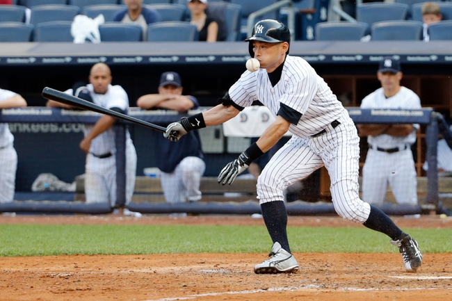 Sep 2, 2013; Bronx, NY, USA;  New York Yankees right fielder Ichiro Suzuki (31) gets hit by ball as it bounces back during the eighth inning against the Chicago White Sox at Yankee Stadium. Yankees won 9-1.  Mandatory Credit: Anthony Gruppuso-USA TODAY Sports