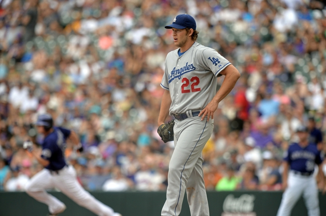Sept 2, 2013; Denver, CO, USA; Los Angeles Dodgers starting pitcher Clayton Kershaw (22) reacts to giving up a double base hit in the fifth inning against the Colorado Rockies at Coors Field. Mandatory Credit: Ron Chenoy-USA TODAY Sports