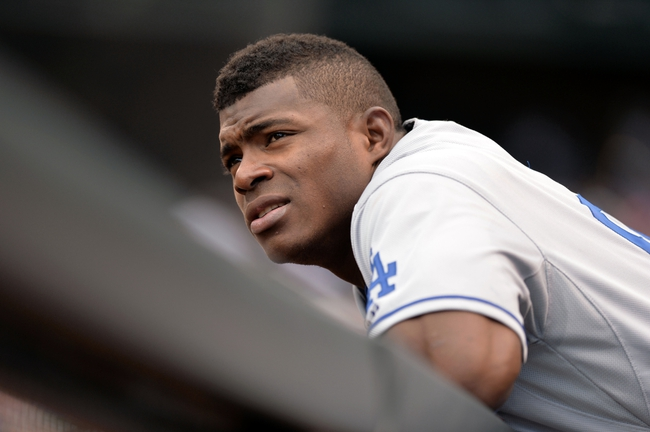 Sept 2, 2013; Denver, CO, USA; Los Angeles Dodgers right fielder Yasiel Puig (66) during the game against the Colorado Rockies at Coors Field. Mandatory Credit: Ron Chenoy-USA TODAY Sports