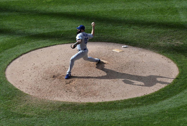 Sept 2, 2013; Denver, CO, USA; Los Angeles Dodgers relief pitcher Brian Wilson (00) delivers a pitch in the seventh inning against the Colorado Rockies at Coors Field. The Dodgers defeated the Rockies 10-8. Mandatory Credit: Ron Chenoy-USA TODAY Sports