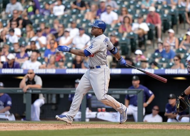 Sept 2, 2013; Denver, CO, USA; Los Angeles Dodgers left fielder Carl Crawford (25) hits a ground rule double in the ninth inning against the Colorado Rockies at Coors Field. The Dodgers defeated the Rockies 10-8. Mandatory Credit: Ron Chenoy-USA TODAY Sports