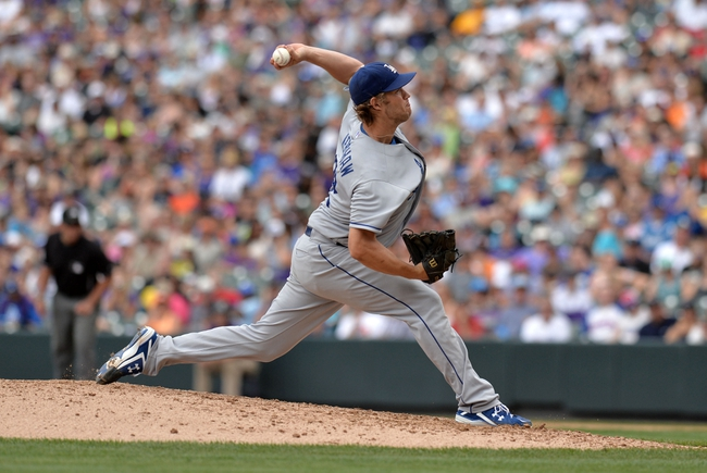 Sept 2, 2013; Denver, CO, USA; Los Angeles Dodgers starting pitcher Clayton Kershaw (22) delivers a pitch in the fourth inning against the Colorado Rockies at Coors Field. The Dodgers defeated the Rockies 10-8. Mandatory Credit: Ron Chenoy-USA TODAY Sports