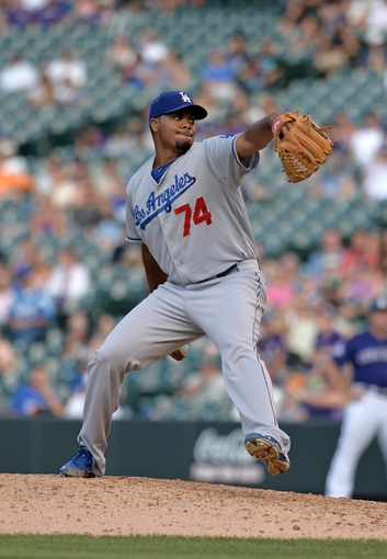 Sept 2, 2013; Denver, CO, USA; Los Angeles Dodgers relief pitcher Kenley Jansen (74) pitches in the ninth inning against the Colorado Rockies at Coors Field. The Dodgers defeated the Rockies 10-8. Mandatory Credit: Ron Chenoy-USA TODAY Sports