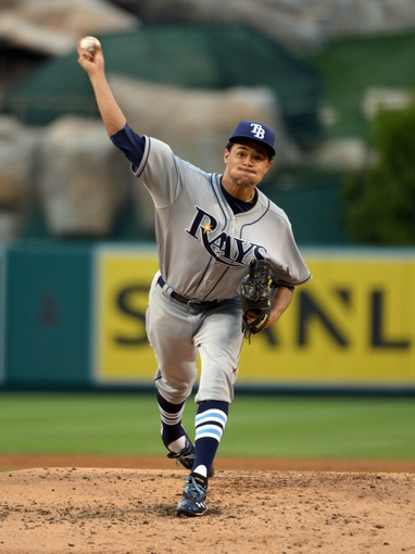 Sep 1, 2013; Anaheim, CA, USA; Tampa Bay Rays starter Chris Archer (22) delivers a pitch against the Los Angeles Angels at Angel Stadium. Mandatory Credit: Kirby Lee-USA TODAY Sports