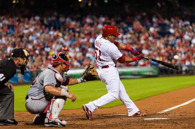 Sep 2, 2013; Philadelphia, PA, USA; Philadelphia Phillies catcher Carlos Ruiz (51) hits a broken bat RBI single during the fourth inning against the Washington Nationals at Citizens Bank Park. The Phillies defeated the Nationals 3-2. Mandatory Credit: Howard Smith-USA TODAY Sports