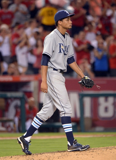 Sep 1, 2013; Anaheim, CA, USA; Tampa Bay Rays starter Chris Archer (22) reacts after surrendering a two-run home run to Los Angeles Angels shortstop Erick Aybar (not pictured) in the fourth inning at Angel Stadium. Mandatory Credit: Kirby Lee-USA TODAY Sports