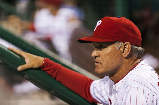 Sep 2, 2013; Philadelphia, PA, USA; Philadelphia Phillies interim manager Ryne Sandberg (23) watches from the dugout during the eighth inning against the Washington Nationals at Citizens Bank Park. The Phillies defeated the Nationals 3-2. Mandatory Credit: Howard Smith-USA TODAY Sports