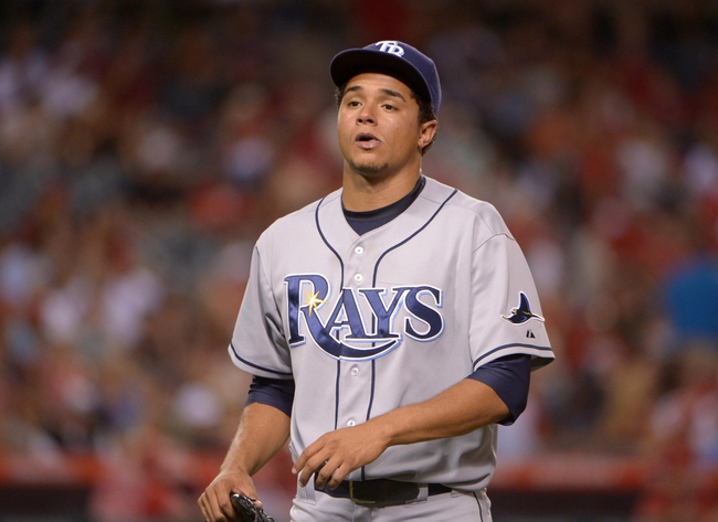 Sep 2, 2013; Anaheim, CA, USA; Tampa Bay Rays starter Chris Archer (22) reacts after being removed in the fourth inning against the Los Angeles Angels at Angel Stadium. Mandatory Credit: Kirby Lee-USA TODAY Sports