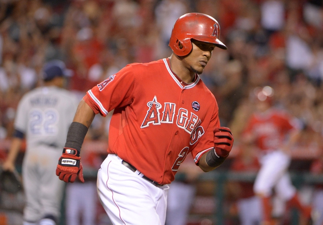 Sep 2, 2013; Anaheim, CA, USA; Los Angeles Angels shortstop Erick Aybar (2) rounds the bases after hitting a two-run home run off of Tampa Bay Rays starter Chris Archer (22) in the fourth inning at Angel Stadium. Mandatory Credit: Kirby Lee-USA TODAY Sports