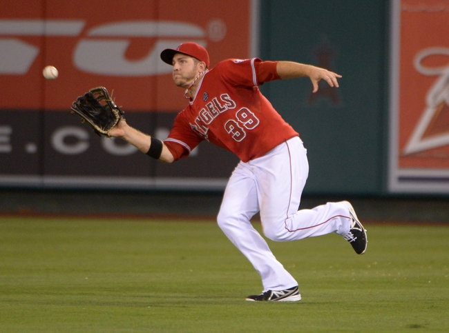 Sep 2, 2013; Anaheim, CA, USA; Los Angeles Angels right fielder J.B. Shuck (39) catches a fly ball by Tampa Bay Rays left fielder Matt Joyce (not pictured) in the fifth inning at Angel Stadium. Mandatory Credit: Kirby Lee-USA TODAY Sports