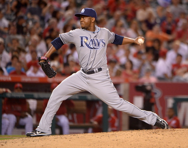Sep 2, 2013; Anaheim, CA, USA; Tampa Bay Rays reliever Wesley Wright (49) delivers a pitch in the fourth inning against the Los Angeles Angels at Angel Stadium. Mandatory Credit: Kirby Lee-USA TODAY Sports